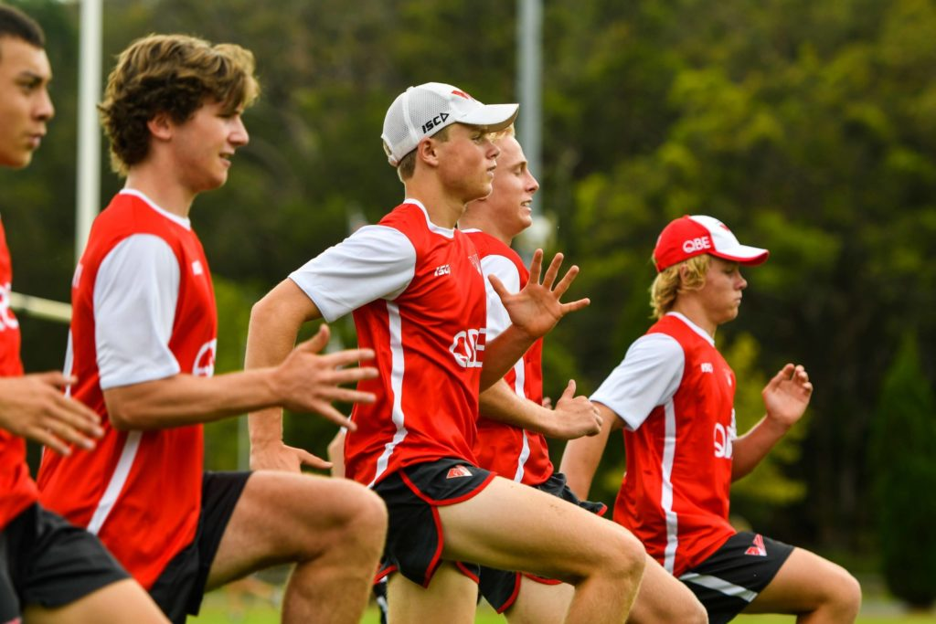 QBE Sydney Swans Academy boys running during training