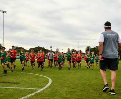 QBE Sydney Swans Academy Coach speaking to players running