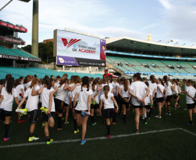 SB Sydney Swans Academy Youth Girls stretching during training