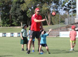 Heath Grundy during a Swans Community Camp.